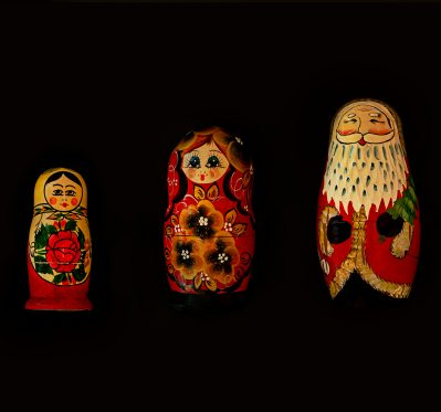 three assorted colour nesting dolls