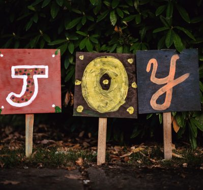 Three signs spelling out the word JOY