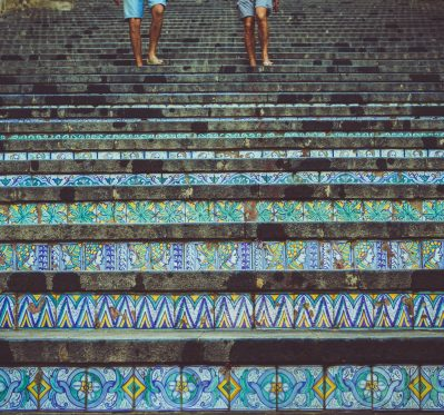 Two people walking down stairs